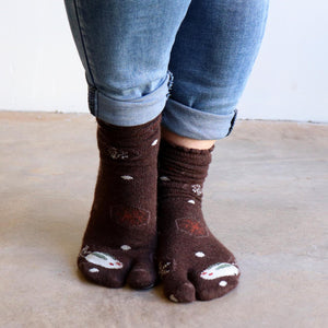 Tip Toe Tabi Sock may also be known as Sandal Socks? Birkenstock Socks? Two-Toe Socks? Dance Socks? Flip-flop Socks? Thong Socks? Ninja Socks! Snowflake Chocolate Brown front view.