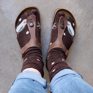 Tip Toe Tabi Sock may also be known as Sandal Socks? Birkenstock Socks? Two-Toe Socks? Dance Socks? Flip-flop Socks? Thong Socks? Ninja Socks! Snowlake Chocolate Brown looking down.