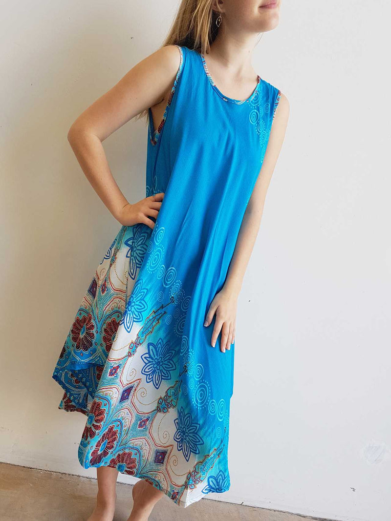 Onesize, softly draping rayon sleeveless Summer dress in swirl print. Available in Navy, turquoise blue, black and teal green - fits sizes small - extra large.
