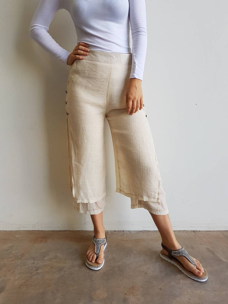 Womens light + floaty two layer 7/8 pant with button features. High waisted summer cotton blend pant. Nude Beige,