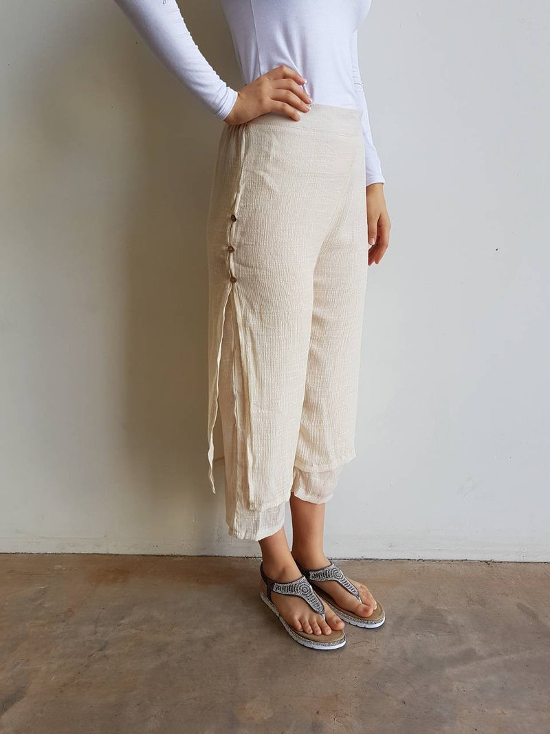 Womens light + floaty two layer 7/8 pant with button features. High waisted summer cotton blend pant. Nude Beige.