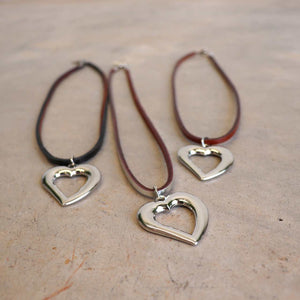 Heart shaped silver pendant combined with a natural leather band available in 3 colours, Black, Silver and Tan.