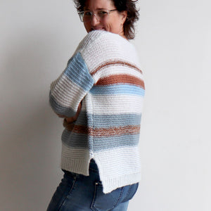 Valley V-neck Knit Jumper is a soft mohair-feel winter sweater made with cotton. White. Side view.