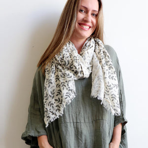 A wonderfully delicate cotton scarf that is naturally dyed and ethically produced. Natural.