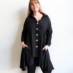 Walk This Way long sleeve tunic top. Created with funky over-size button detail with two handy pockets. Linen/Rayon fabric.