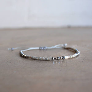 Fine stone and cut glass beaded bracelet. Handmade with knotted slide fastener. Silver.