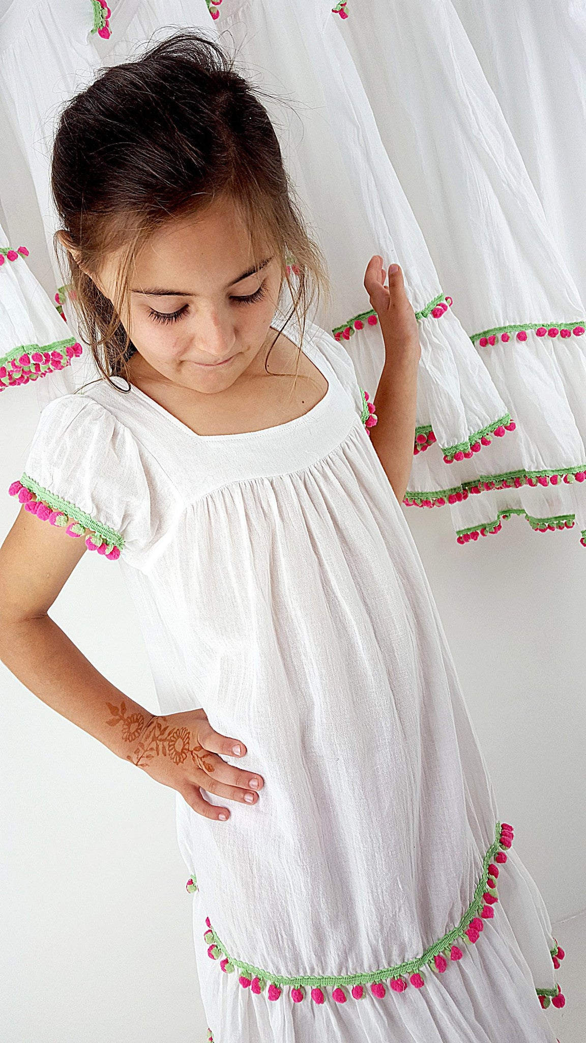 5a69373fab7b9 Size · Lightweight little girls peasant style Summer frock with pom pom  detailed hem. White.