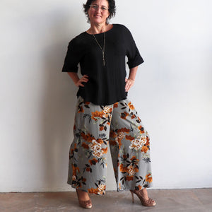 West End Pant - Wide-leg style in funky retro floral print for workwear and smart casual. Leg view.