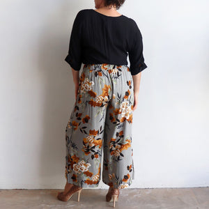 West End Pant - Wide-leg style in funky retro floral print for workwear and smart casual. Back view.
