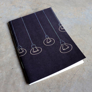 32 blank page notebook. 10cm x 14cm dimensions.