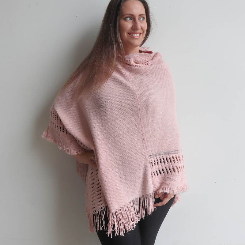 Our 'Whistler Poncho' with the added hood combining a detailed knitted pattern and finishing tasselling. Dusty Pink.