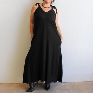 Women's linen blend A-line cut pinafore dress. Versatile, pocketed all-weather dress with sweeping hem-line. Sizes S/M - L/XL. Black.