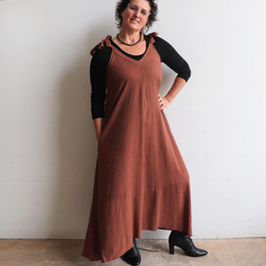Women's linen blend A-line cut pinafore dress. Versatile, pocketed  all-weather dress with sweeping hem-line. Sizes S/M - L/XL. Cinnamon.
