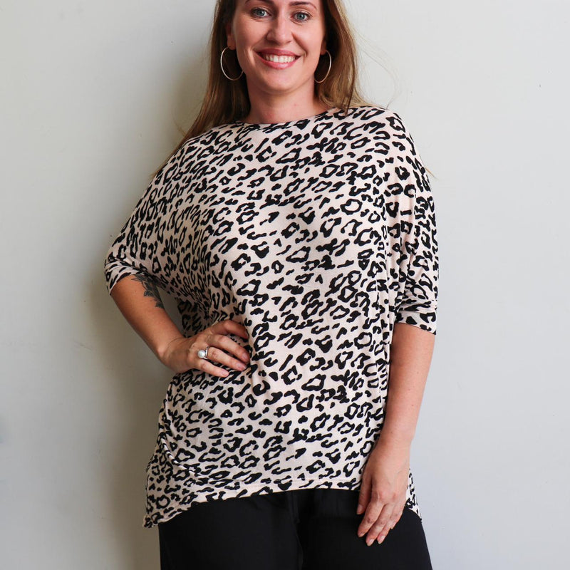 Sassy animal print Slouch Knit Top in stretch mesh fabric. Designed as a loose and oversized winter top that styles well on both regular and plus size shapes