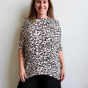 Sassy animal print Slouch Knit Top in stretch mesh fabric. Designed as a loose and oversized winter top that styles well on both regular and plus size shapes.