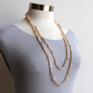 Freshwater pearls and cut glass beads. Hand knotted. 155cm full length. Champagne.