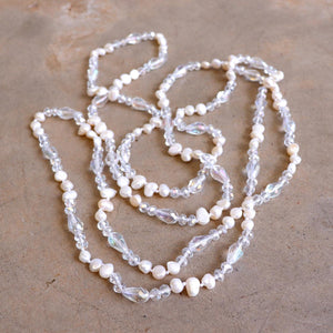 Freshwater pearls and cut glass beads. Hand knotted. 155cm full length. Ivory.