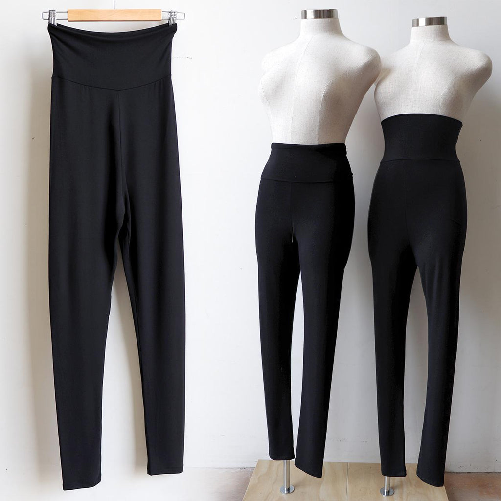 Super comfortable jeggings made with an ultra-wide waistband for all day wear. Made from double-stretch luxe bamboo rayon/spandex, for active wear or to layer beautifully under dresses and basics. Black.