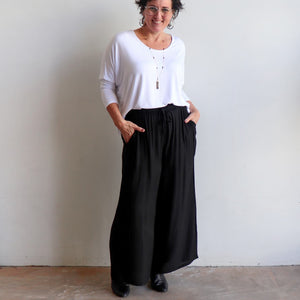 Zen Drawstring Lounge Pants - Classic black wide-leg, pull-on trousers in plus-size fitting. Front view.