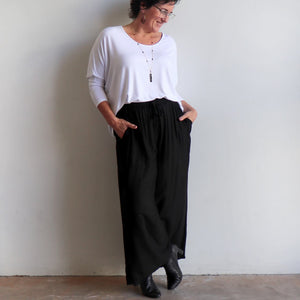 Zen Drawstring Lounge Pants - Classic black wide-leg, pull-on trousers in plus-size fitting. Karen wearing size L/XL.