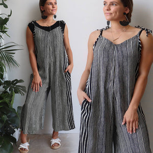 In Cahoots Jumpsuit - Adjustable overalls in modern stripe designed for small to plus sizes. Black. Sleeveless and short sleeve view.