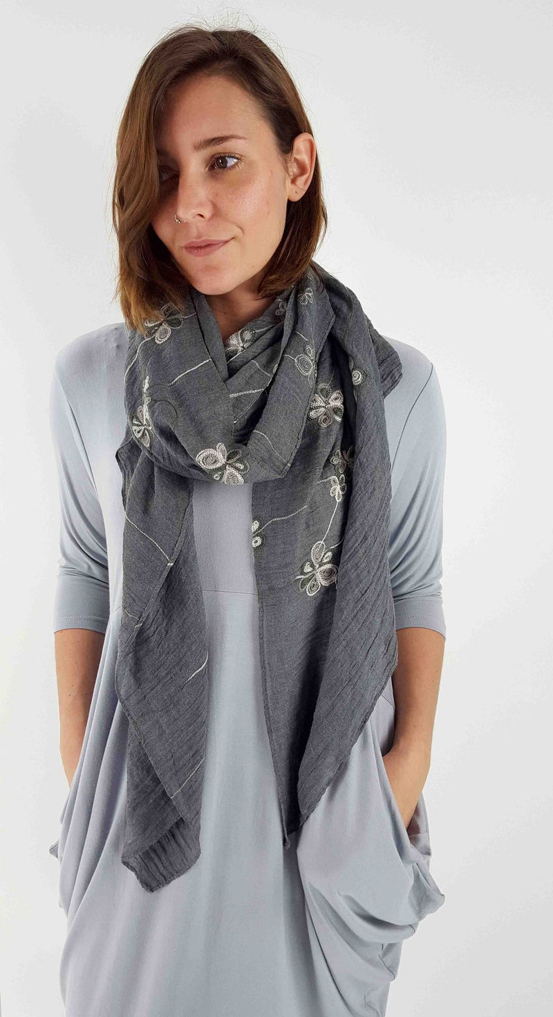 Soft oversized viscose 'winter garden' scarf wrap with embroidery detail.