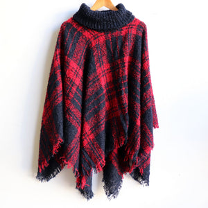 Warm winter Poncho, thick and soft roll-neck top. Easy throw on, in a classic tartan print. Made with no itch acrylic.