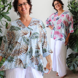 Lucy in the Sky women's blouse, a light roomy summer top in a lovely tropical print . A loose 3/4 sleeve gives plenty of arm coverage on warm days. Made with easy-care 100% rayon fabric. Available in S/M + L/XL.
