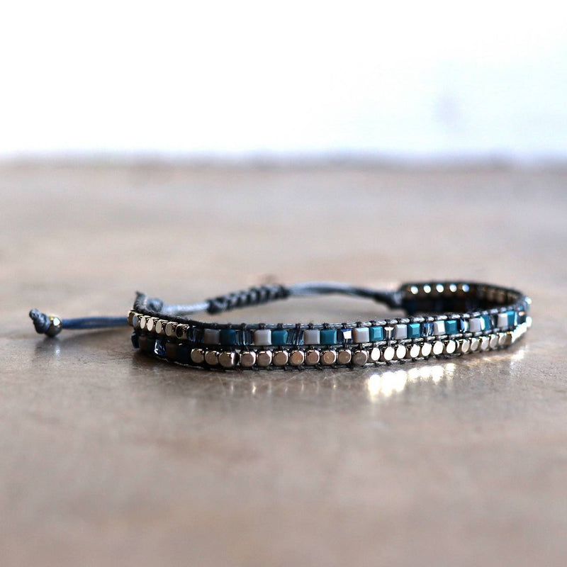 Intricately handmade bracelet, threaded and knotted using an ethnic technique with stone and metal beads. Slide fastening for flexibility and comfort.