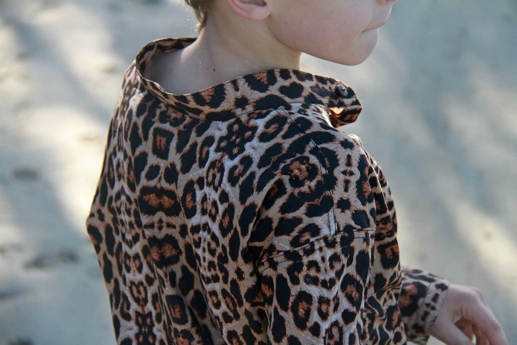 Boy's quality cotton animal print button up shirt. Sizes 6 months to 10 years.