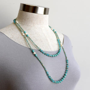 Handmade, long-strand necklace of baroque pearls, turquoise and faceted glass beads in aqua blue and ivory with flecks of gold. 140cm full length.