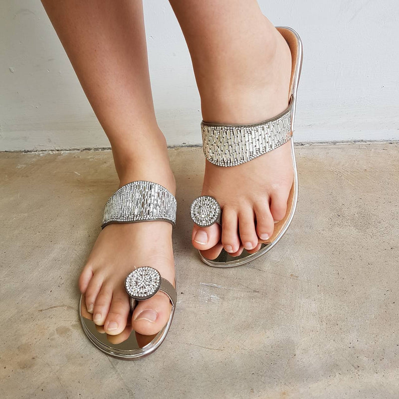 Slide on summer sandal with lots of bling! Beautiful women's flat shoe for special occasions.