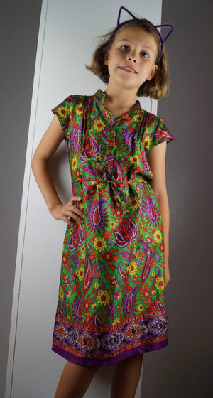 Girl's cotton shirt dress with cap sleeve. Green and purple paisley print made with sari fabric. Sizes baby to tweens.