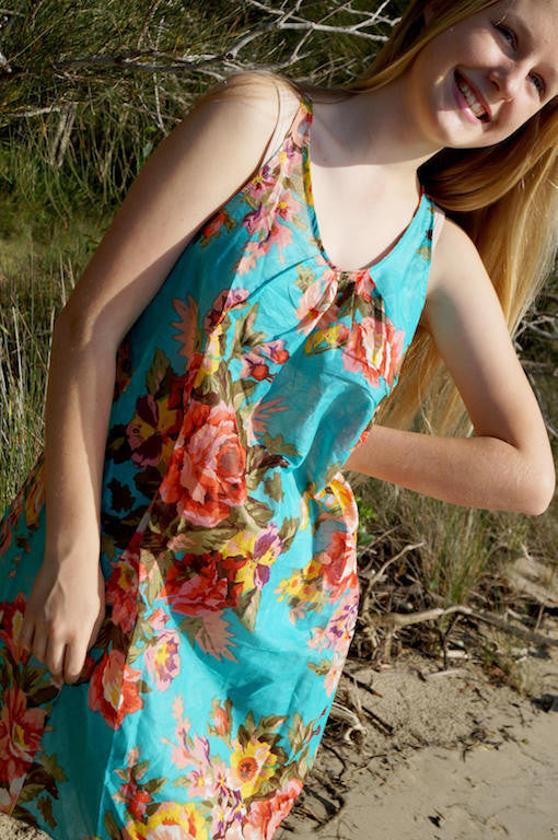 Here Comes the Sun Dress. Ethically produced light cotton knee-length dress. Floral turquoise blue.