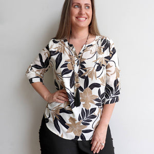 Classic cut women's summer top, features 3/4 cuffed sleeves with button fastening. Designed in a brilliant floral print in a cotton-feel rayon. Available in sizes 8-20. Natural.