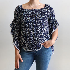 Moondance Blouse a gypsy inspired womens top in a pretty floral print. True to size fitting summer top made in rayon fabric. Sizes 8-16. Navy Blue.