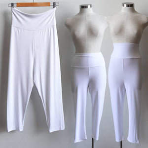 Super comfortable leggings made with an ultra-wide waistband for all day wear. Made from double-stretch luxe bamboo rayon/spandex, for active wear or to layer beautifully under dresses and basics. White.