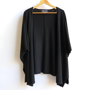 Kimono style throw-over cardigan made with soft cotton yarn and plenty of stretch. Versatile and open-front style designed to flatter all shapes. from size 10 to plus sizes. Black.