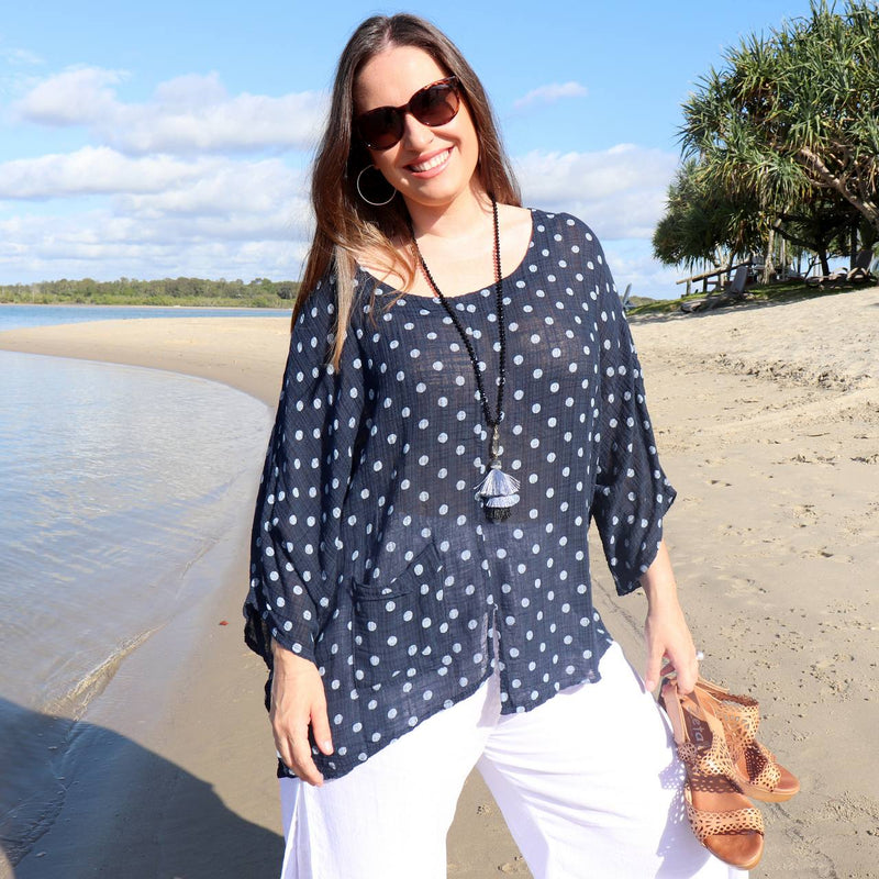 Ladies polka dot kaftan shirt top with 3/4 sleeve, pocket and asymmetrical hemline. Pure 100% linen and made in Italy. Generous cut fits petite to plus size - Navy blue