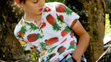 Boy's short sleeve Henley t-shirt with tropical pineapple print. Ethically handmade by our Kobomo team. Sizes 1 to 10 years.