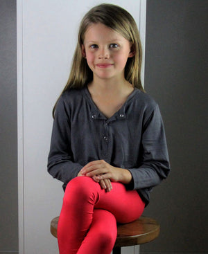 Classic long sleeve t-shirt top for boys and girls. Comfy staple with snap button feature. Sizes to fit newborns, toddlers, kids and tweens up to 10 years old. Ethically handmade with soft, stretch bamboo spandex. Charcoal Grey