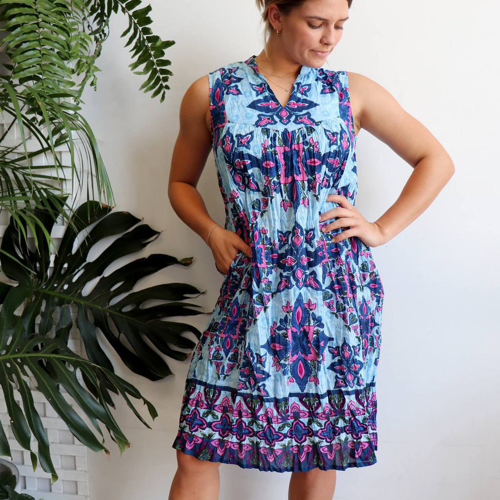 All Summer Long Cotton Tunic Dress. Sleeveless women's dress manufactured with 100% cotton in a wonderful print. Available in sizes 10-20.
