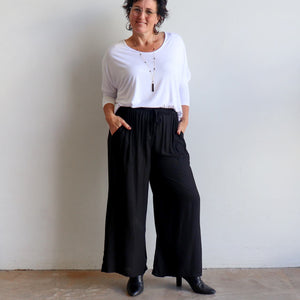 Zen Drawstring Lounge Pants - Classic black wide-leg, pull-on trousers in plus-size fitting.