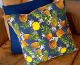 Square cushion cover made with tropical pineapple print on denim fabric. Ethically produced by KOBOMO.