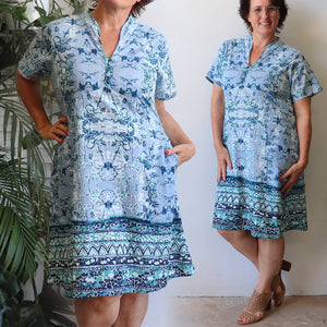 Short sleeved women's summer dress with below the knee hemline. Designed with a flattering v-neck + under-bust seaming in a striking summer print. Made from 100% cotton. Sizes 10-20.