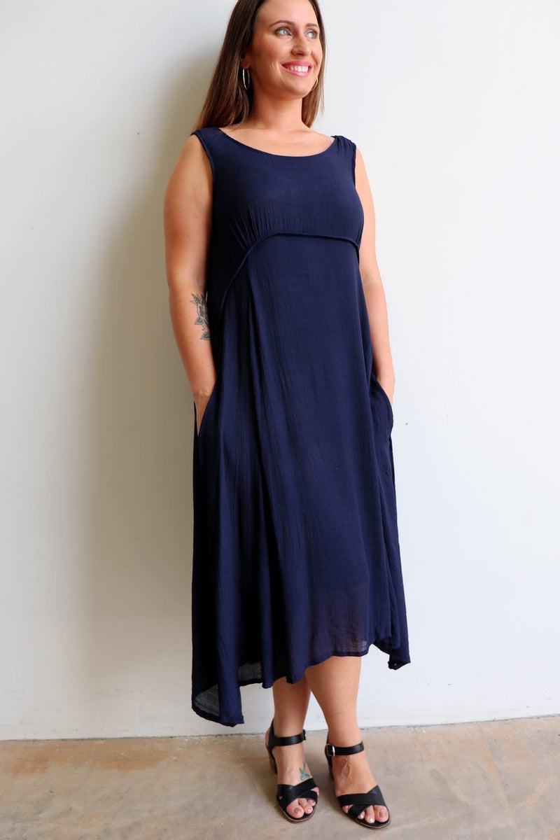 The Abbey Road Dress is a sweeping, midi-length skirted dress with flattering empire line bust. Navy Blue.