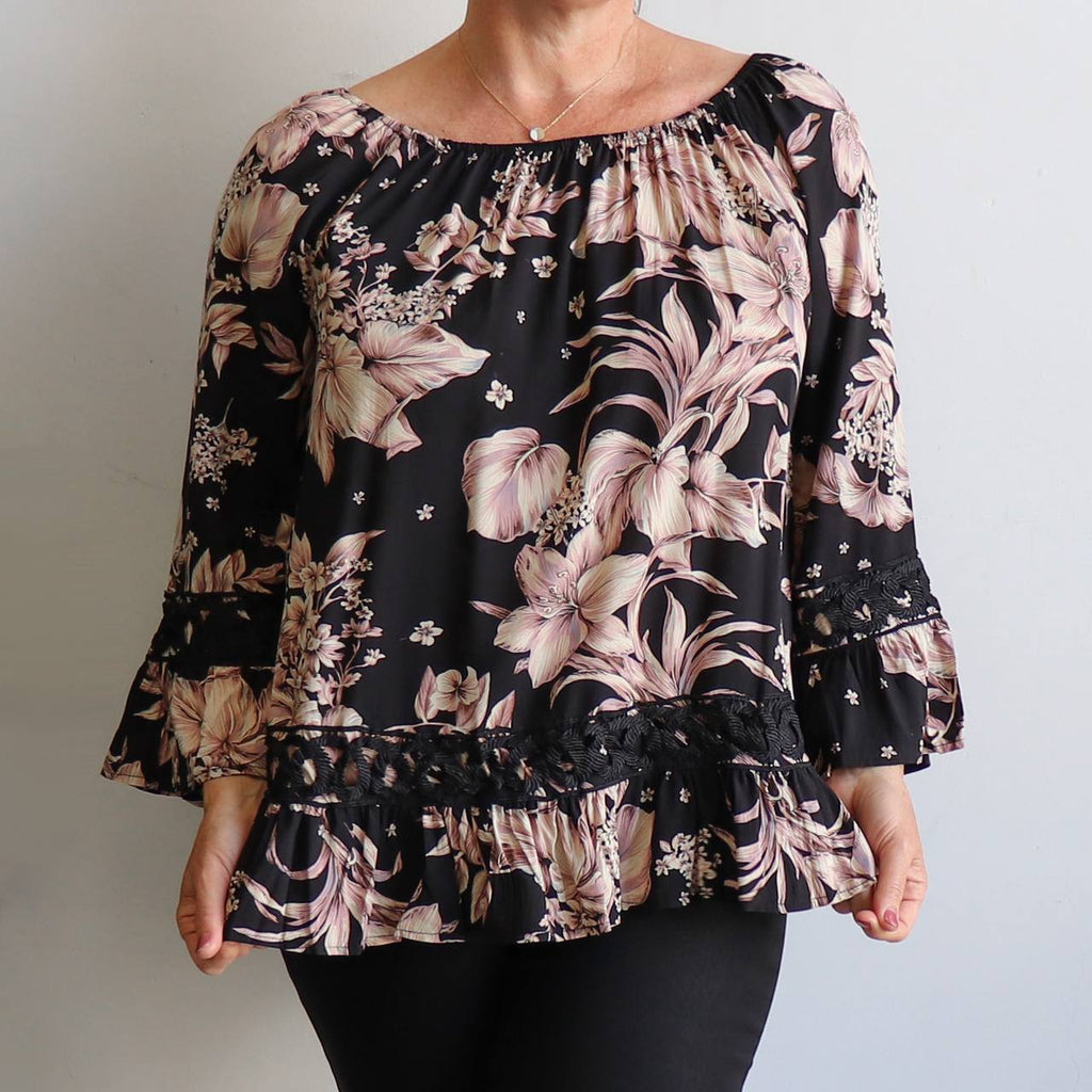 Summer Nights Blouse. Long Sleeve women's top in floral pattern made in a quality rayon fabric. True to fit sizing 8-18.