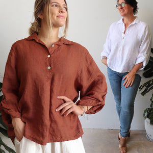 Pure Italian linen women's blouse. Summer top features a mother-of-pearl button feature on the back and roomy cut to sleeves. Available in sizes M-XL.