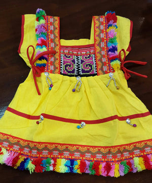 Girl's Hill Tribe Tunic Dress with rainbow pompom trims and traditional tapestry. Yellow.