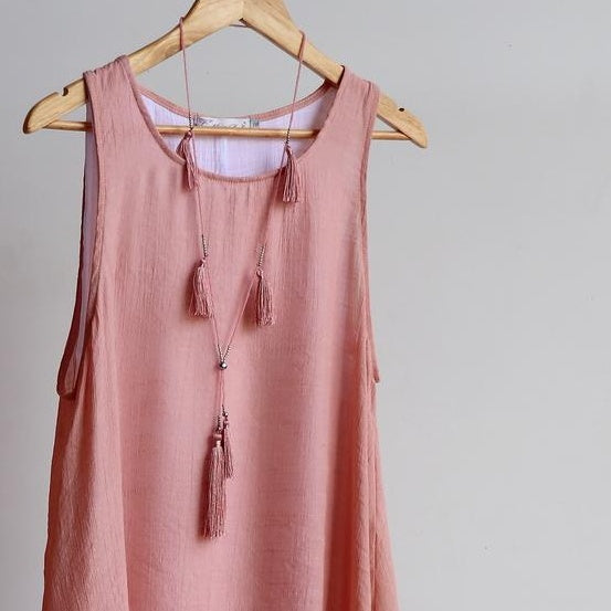 Silky tassels and glass bead longer length necklace. Handmade in soft colours of  blush pink, nude beige and burgundy.